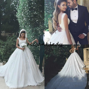 2018 Arabic Ball Gown Wedding Dresses Spaghetti Backless Appliques Beads Cathedral Train Chapel Castle Bridal Gowns Customized Ivory Cheap
