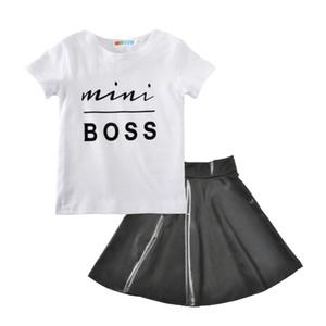 Babyausstattungssommer 2018 scherzt Chefbuchstabe T-Shirt + PU-Rock 2pcs / set Baumwollboutiquekinder Kleidungs-Sätze H001