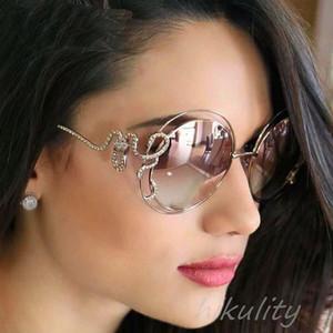 Gafas de sol de lujo diamante Rosa gafas de sol redondas mujeres único Rhinestone serpiente diseñador gafas de sol mujer damas sombras