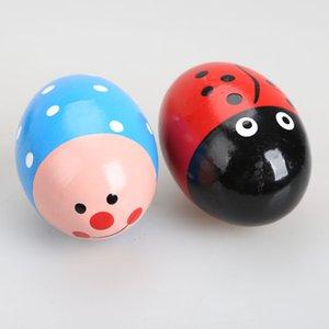5 pz bambino uovo di legno sonaglio giocattolo bambino neonato sonagli bambino musica in legno shaker uovo colorato bel cartone animato gioca giocattolo