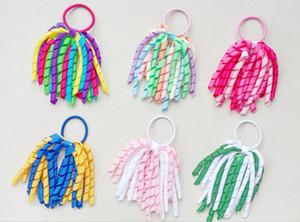 Muchacha de la mujer accesorios para el cabello A-korker Ponytail de la borla de rizo korker cintas serpentinas arcos cilp horquillas elásticas banda de pelo 100pcs PD002