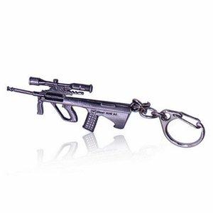 Lindo Llavero en color retro GUN encantos Juego en línea FireWire AK47CF regalos de Navidad fuera de la Florida Bolsa coche Llaveros