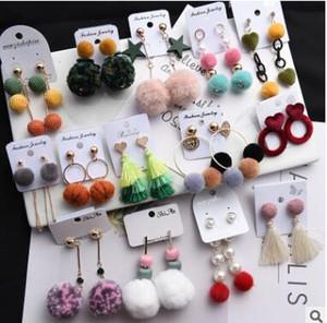 Pendientes de bola de lana de estilo largo súper personalidad de la bola de terciopelo de hadas exagerada oreja femenina caída muchos estilos