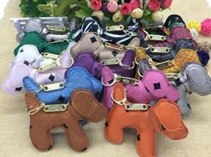 Nuevos encantos llavero moda mochila cadena colgante creativo Unisex Pu Animal perro mochila llavero regalo