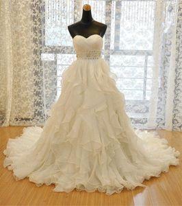 NOUVEAU ORGANZA GOES DE MARIAGE PERADING COUTEAU SWEETETHEART TRAVEUR Robe de mariée à robe de mariée avec robes de mariée blanche à volants