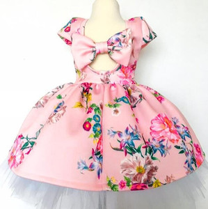 Nuevas muchachas vestido impreso floral ahuecado Volver grande del arco de los bebés vestidos de arco transpirable Verano fresco falda traje 2-7T babys ropa de niña