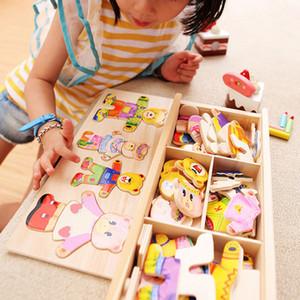 Quattro cuccioli cambiano vestiti gioco bambini in legno mano precoce afferrando il vestito di corrispondenza giocattoli di puzzle prezzo di fabbrica all'ingrosso 1 pezzi o più