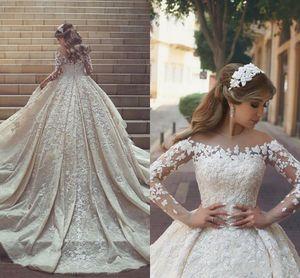 2018 화려한 레이스 웨딩 드레스 깎아 지른 목발 긴 기차 긴 소매 크리스털 프릴 아플리케 Arabic Dubai Wedding Gowns Custom Made