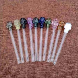 10 unids Venta al por mayor Skull Glass Diseño único Oil Burner Pipe Mini Pyrex Pyrex Color Fumar Agua Tubos de agua Hand Burner para DAB SW13