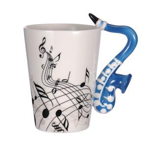 Tazas de leche de cerámica Guitarra Personalidad de cerámica Nota musical Jugo de leche Taza de limón Café Taza de té Oficina en el hogar Drinkware Regalo único