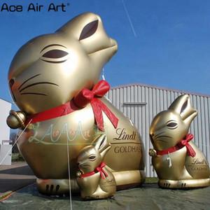 opcional tamaño grande y hermoso / decoración al aire libre de conejo inflable de dibujos animados inflable globo de oro de conejo atado con un lazo rojo