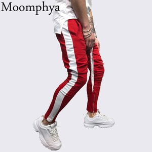 Moomphya Pantaloni da jogging uomo a righe laterali eleganti Pantaloni da uomo hip-hop Streetwear pantalon homme Pantaloni pantaloni a cerniera sottili