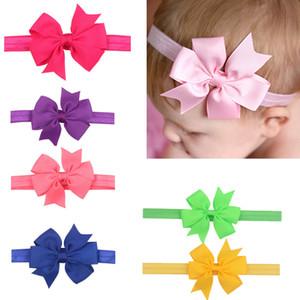 Los niños de la niña del color del caramelo del arco del arco Hairband cinta de la mariposa de la cuerda del pelo 20 colores de moda joyería del pelo