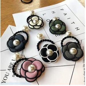 Gute Qualität Kamelienblume Tuchperlenhaargummibänder Bungeehaarring-Haar acc 6 Farben