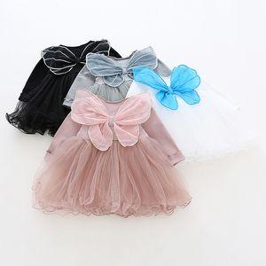 Vestido de ropa de niña primavera 100% algodón O-cuello de manga larga mariposa Malla de mariposa Malla de parche de diseño Vestido de niña Cómodo.