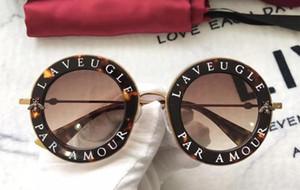 Nuovo designer 0113S Occhiali da sole per le donne Moda 0113 Tondo Stile estivo Nero Oro Telaio di alta qualità Protezione UV Lens Com con scatola