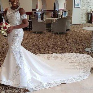Impresionante sirena africana Vestidos de novia Perlas Apliques de encaje Bordado Florales 3D Vestidos de novia Glamorosa manga corta Vestidos de novia largos