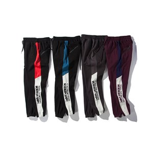 Pantaloni da uomo a righe laterali tenere il passo lettera stampata con pannelli Jogger pantaloni atletici pantaloni della tuta maschile Hip Hop High Street Pantalone