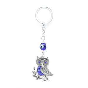 2018 New Starfish Owl Elephant Dolphins Animal Portachiavi Occhi diabolici blu con borsa da donna in cristallo Portachiavi in argento llavero