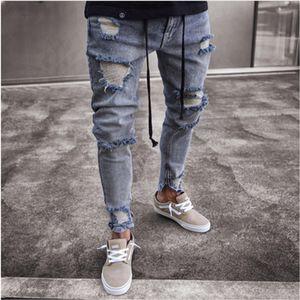 Hombres hip-hop apretados slim fit con cremallera agujero estrecho pierna pantalones hombres jeans Slim Fit hombres unidos pies cremallera Europa y América