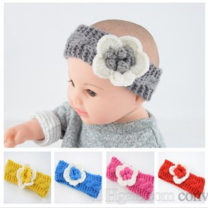 Nueva Baby Girls Fashion Wool Crochet Headband Cross Knit Hairband con decoración floral Winter Newborn Infant Ear Warmer Head Headwrap KHA303