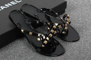 Brand New 2018 Frau Sommer Sandalen Nieten große Bowknot Flip Flops Strand Sandalias Femininas Flache Gelee Designer Sandalen