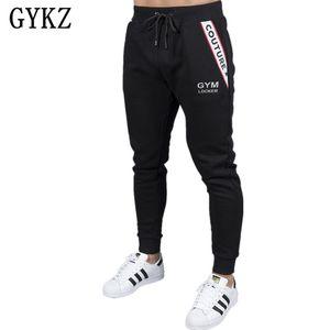 GYKZ Marca de Alta qualidade homens calças de Fitness Casual Elastic Basculadores musculação roupas casuais sweatpants corredores pant