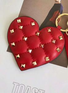 Nouveau hangbag suspendu accessoires cheval en forme de coeur étoiles miroir plein rivets belle mode cuir véritable et métal sac cintre pièces crochet