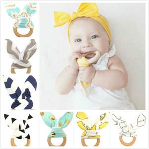 Новый ребенок прорезыватель деревянное кольцо детские моляры зубы обучение игрушки младенцы ручной погремушки новорожденных Babys подарок упражнения игрушки 10 шт. много