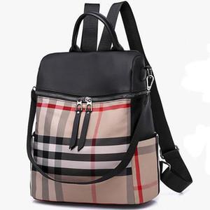 Sac à dos de voyage en gros pour femmes Sac à dos d'affaires Marque Backpack sac à bandoulière à rayures pour femme sac à bandoulière dames sauvages simples sacs à dos