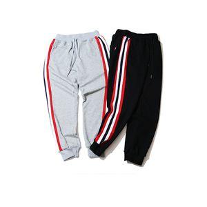 Оптовая бесплатная доставка пара хлопок женщины мужчины свободный стиль sweatpant сторона полосатый повседневные брюки талия эластичный гарем брюки