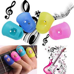 4pcs / Seti Silikon parmak ucu Bass Ukulele Gitar Öğrenci Renk Random için Caps Koruyucu Güvenlik Parmak Bakımı Kapaklar
