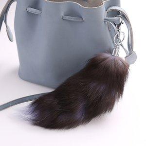Nette flauschige Tasche Anhänger Pompons echte Fox Fur Tail Keychians Plüsch Pom Poms Frauen Geschenke Schlüsselanhänger Auto KeyChain