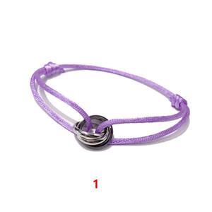 Bijoux de mode de commerce extérieur Belle bracelet en acier de titane chaud argent noir brillant petite dragonne à trois anneaux de couleur