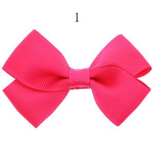 clip di 12pcs Nuovo Ribbon Bow BAMBINA parte superiore dei capelli clip dot solido Stampato della forcella dell'arco per gli accessori dei bambini del bambino per il regalo dei capelli HC060-1