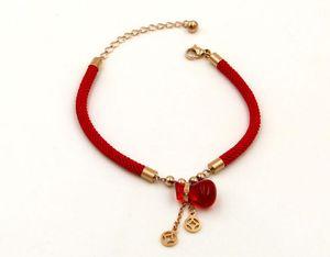Neues geborenes glückliches rotes Seil des Glücks rote Schatzbeutelarmbandtitanstahlrosenrotes Kürbisarmband