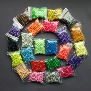 10 Bolsas al por mayor Solid Bead Refill Pack 24 Color Sticky Perler Pegboard Set Jigsaw Juguetes Educativos Puzzle 200 unids / bolsa