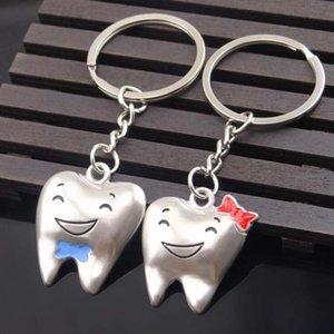 Venta al por mayor de dientes de dibujos animados llavero dentista decoración llaveros modelo de diente dental de acero inoxidable regalo envío gratis
