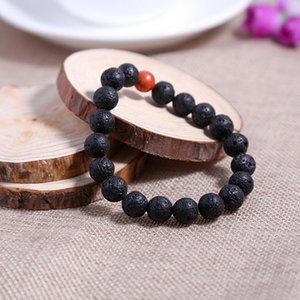 Дизайн высокого класса мужчины ювелирные изделия 8 мм черный лавовый камень и синий морской осадок камень шарик с 24 K золотой череп браслет