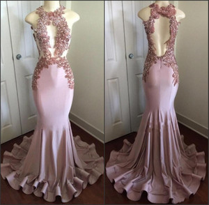 Sexy Pink Mermaid Prom Dresses 2018 New Halter Neck con cuentas Appliques Cutaway Backless Evening Party Vestidos Celebrity Pageant Desgaste personalizado