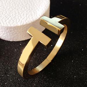 Beaux bijoux en acier de titane de mode en gros épais double T bracelets simple bracelet ouvert symétrique hommes et femmes