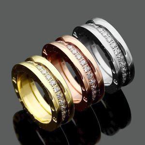 Alta qualità Moda Lady 316 acciaio al titanio singole file Diamond Gear Arc Edge Wedding Engagement 18K placcato oro anelli stretti Size5-10