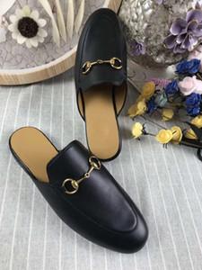 8012.2018 Zapatillas de moda europea perezoso Baotou conejo de cuero plana medio arrastre moda ocio zapatos de las señoras envío gratis
