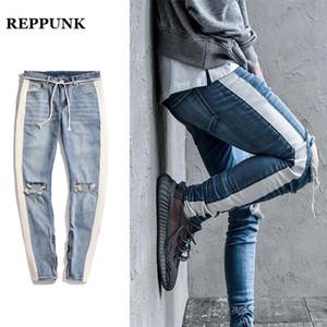 REPPUNK 2018 nuovi pantaloni a vita bassa strappati con cerniera laterale foro cerniera per uomo pantaloni strappati personalità streetwear hiphop pantaloni jeans striscia nera