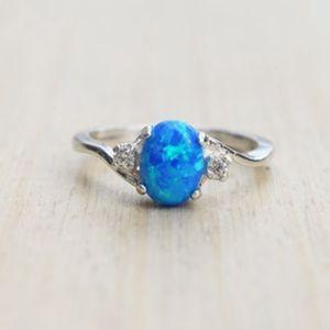 Moda simple clásico moda colorido gran forma de huevo ovalada anillo de ópalo de fuego azul circón cúbico compromiso anillos de bodas para mujeres