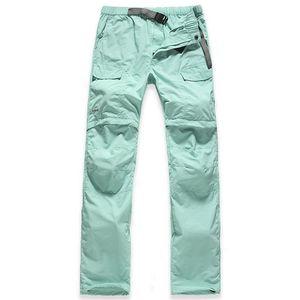 Le donne esterne che si asciugano rapidamente asciugano i pantaloni staccabili che fanno un'escursione i pantaloni di arrampicata di pesca di campeggio all'ingrosso