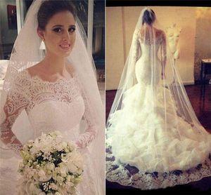 Vintage Lace Long Sleeves Mermaid Wedding Dresses Saudi Arabia Backless Bridal Gown Sheer Bateau Tiered Ruffled Tulle Skirts Gowns
