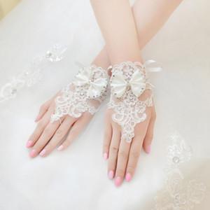Neue 2018 Günstige Lange Brauthandschuhe Spitze Appliques Perlen Fingerlose Handgelenklänge Mit Bogen Brauthandschuhe Hochzeit Zubehör