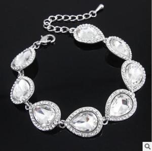 Heiße neue Kristallbrautschmucksachen stellen silberne Farbteardrop-Brautarmband-Ohrringe ein Sätze Hochzeits-Schmucksachen geben Verschiffen frei