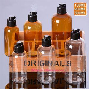 30 unids / lote alta calidad 100 ml 200 ml 300 ml Claro / ámbar Botellas cosméticas líquido Negro tapa superior de lujo botellas de plástico PET plástico